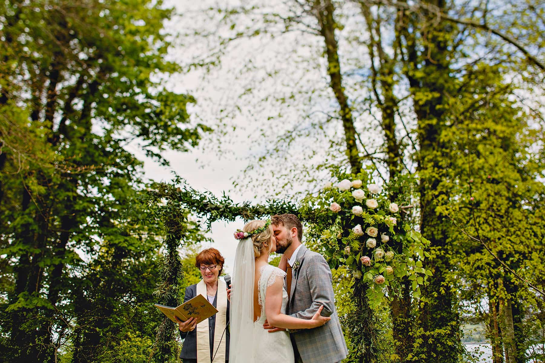 Bride and Groom First Kiss Outdoor Ceremony at Old Court Chapel Northern Ireland Wedding Photographer,