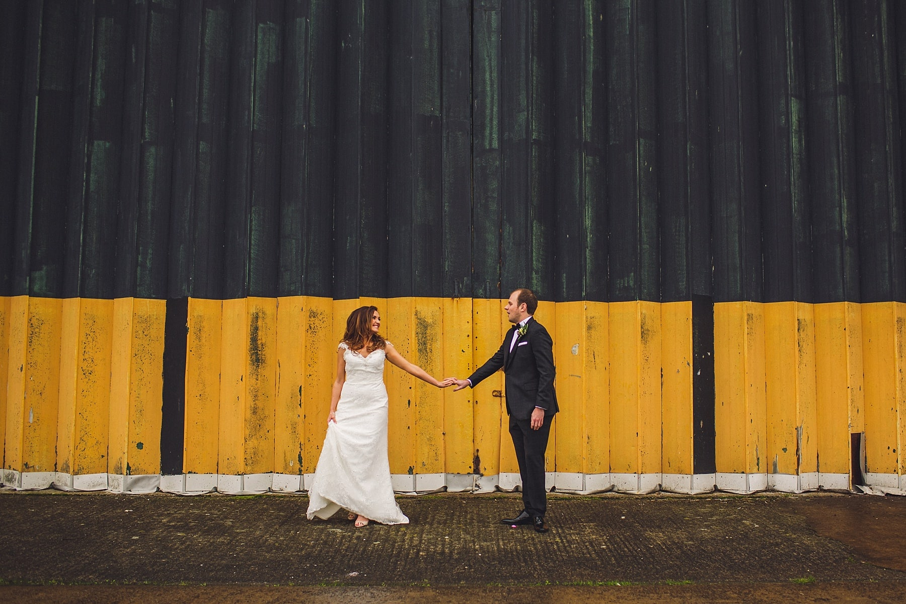 first look,titanic quarter,belfast wedding photographer,happy tears,bride and groom,wedding inspiration,rain,street art,elopement,ss nomadic wedding,