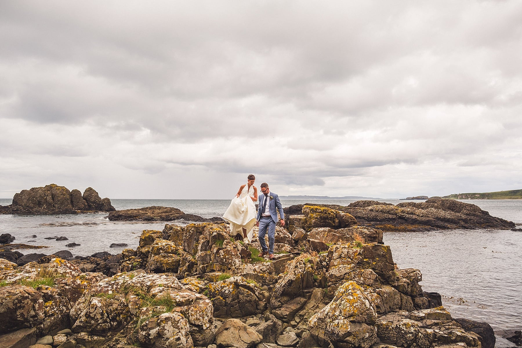 North coast wedding,northern ireland elopement,irish wedding photographer,bride and groom,wedding inspiration,bright,colourful,stylish,adventurous wedding,bride trainers,cliff top wedding,