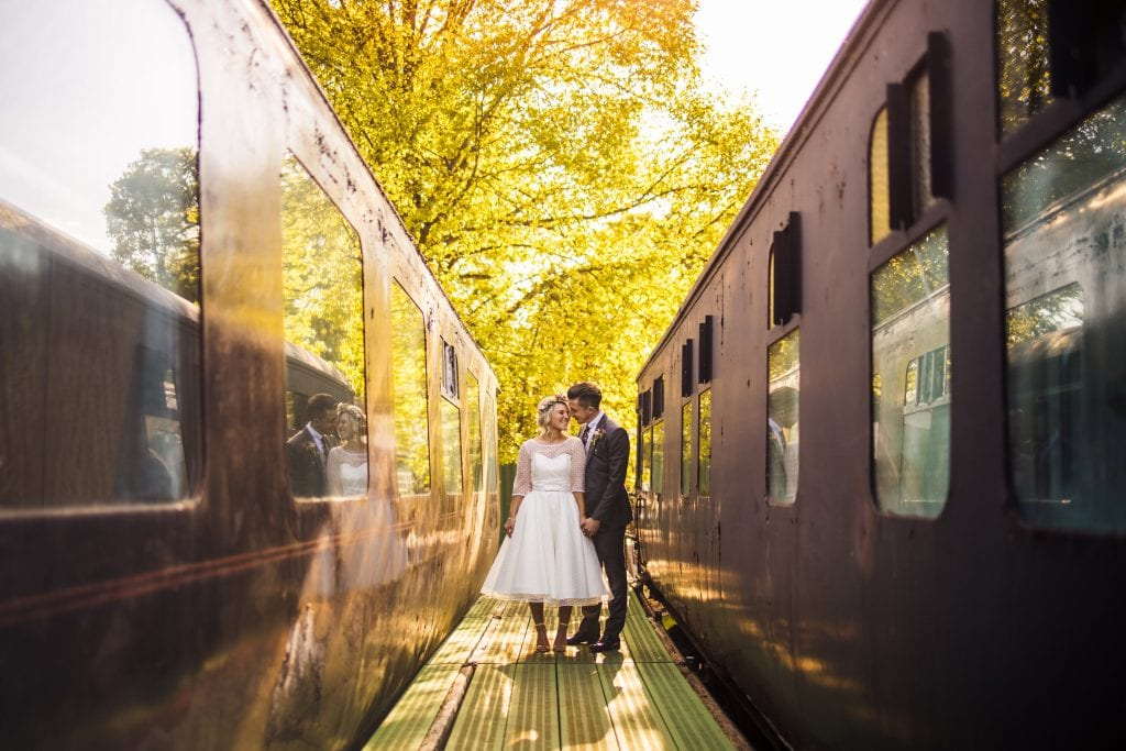 bride and groom, old train station, sunset